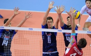 Russia's Victor Poletaev spikes against Italian Luca Borgogno, Edoardo Picco and Luigi Randazzo triple block